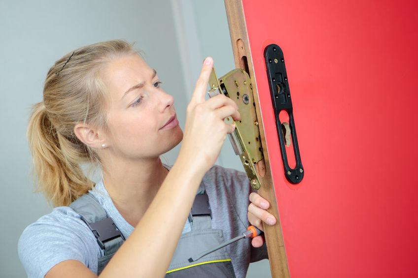 locksmith fixing a lock